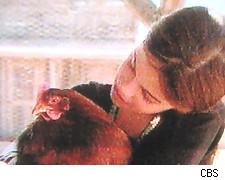 Taylor and a pretty brown chicken on Kid Nation