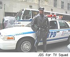 An NYPD motorcycle officer by his car - don't ask why a car