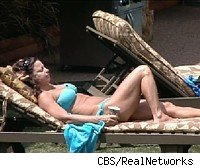 Sheila rests in the Big Brother 9 backyard