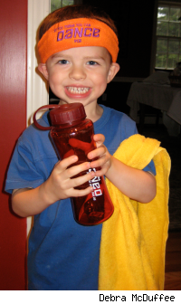 cute kid wearing headband, towel and holding a water bottle