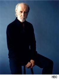 George Carlin on stool