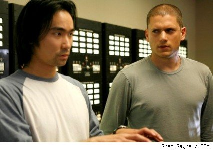 Michael (Wentworth Miller, R) relies on Roland (James Hiroyuki Liao, L) and his computer skills. 