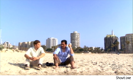 Dexter and Miguel conversing on beach