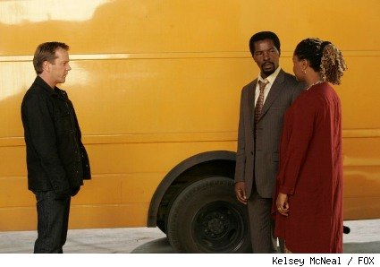 Jack (Kiefer Sutherland, L) tells the Motobos (Isaach De Bankole, C and Tanya Pinkins, R) about his plan.