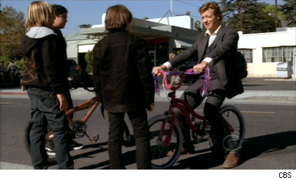Patrick Jane riding a pink bike on The Mentalist