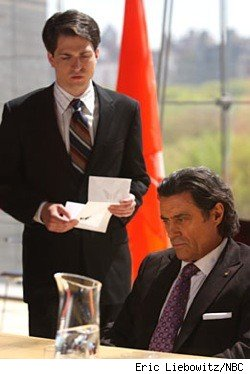 Ian McShane gets some bad news from a runner on the set of Kings