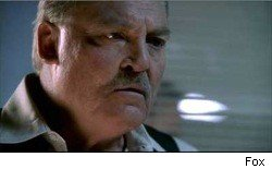 Stacy Keach as the warden on Prison Break