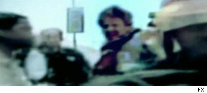Blurry news footage proving that Tommy's cousin Jimmy (James McCaffrey) was still alive after the first tower fell on 9/11/01.
