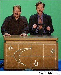 Andy Richter and Conan O'Brien doing a little desk driving