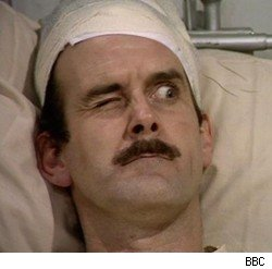 John Cleese is recovering from eye surgery in the UK.