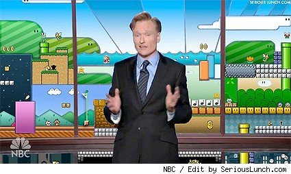 Conan O'Brien in front of the Mario Bros. backdrop