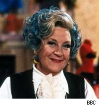 Mollie Sugden as Mrs. Slocombe