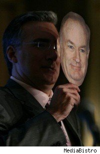 Keith Olbermann hiding behind Bill O'Reilly's giant puppet head