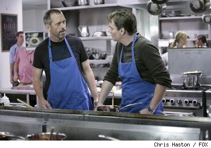 House (Hugh Laurie, L) convinces Wilson (Robert Sean Leonard, R) to take a cooking class with him.
