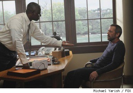 Dr. Nolan (guest star Andre Braugher, L) works with his patient House (Hugh Laurie, R) at Mayfield Psychiatric Hospital in the HOUSE two-hour season premiere.