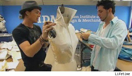 Logan and Christopher work on their outfit on Project Runway