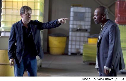 An old friend (guest star Lennie James, R) involves Lightman (Tim Roth, L) in a dangerous deal in the LIE TO ME episode 'Grievous Bodily Harm.'