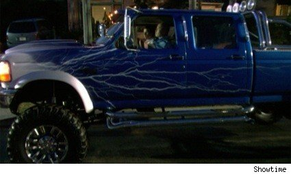 C.S. Lee and Michael C. Hall in Masuka's badass truck on Dexter