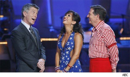 Tom DeLay and Cheryl Burke get a good joke from Tom Bergeron