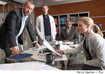 House (Hugh Laurie, L) works with his original team (L-R: Jesse Spencer, Omar Epps and Jennifer Morrison) in the HOUSE episode 'Instant Karma.'