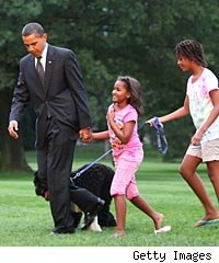 Barack Obama with Malia and Sasha