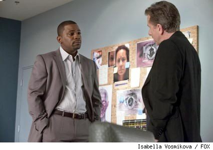 Lightman (Tim Roth, R) unearths dangerous secrets about Reynolds' (Mekhi Phifer, L) past in the 'Lie to Me' episode 'Lack of Candor.'