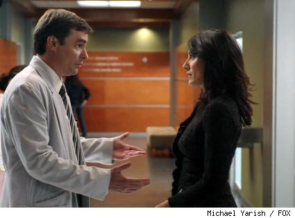 Wilson (Robert Sean Leonard, L) discusses treatment of a patient with Cuddy (Lisa Edelstein, R) in the HOUSE episode 'Wilson.'