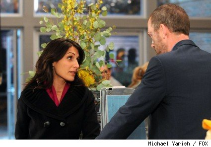 House (Hugh Laurie, R) makes Cuddy (Lisa Edelstein, L) an offer in the HOUSE episode 'Ignorance is Bliss.'