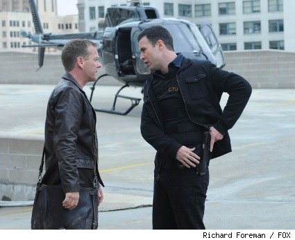 Jack Bauer (Kiefer Sutherland, L) is briefed by CTU field agent Cole Ortiz (Freddie Prinze Jr., R) about the escalating threat.