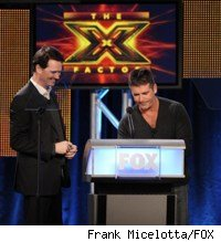 Peter Rice and Simon Cowell at the Winter 2010 TCAs