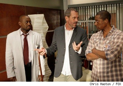 Foreman's (Omar Epps, L) already difficult relationship with his brother Marcus (guest star Orlando Jones, R) becomes worse when House (Hugh Laurie, C)