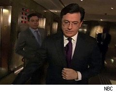 Jimmy Fallon and Stephen Colbert wrestle in an elevator