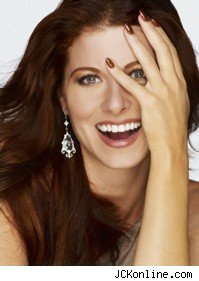 debra_messing_hand_face_smile