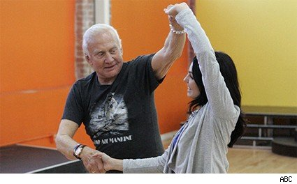 Buzz Aldrin practices with professional Ashly Costa
