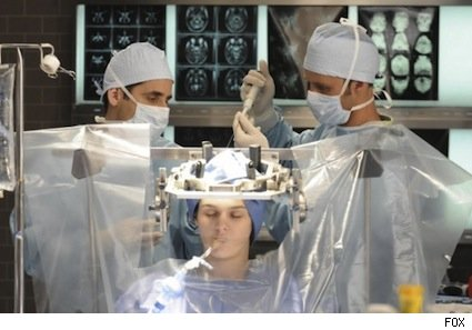 Chase (Jesse Spencer, R) and Taub (Peter Jacobson, L) remove a small section of inflamed brain tissue from their patient, Abby (guest star Cali Fredrichs, C), in the HOUSE episode