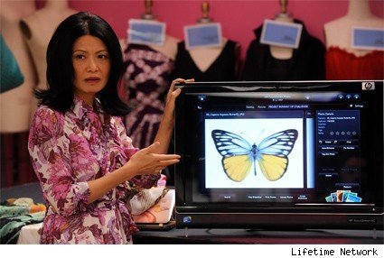  Vivienne Tam shows the contestants a pretty butterfly