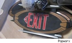 This exit sign from Quark's is just one of the items for sale at Popworx this Saturday.