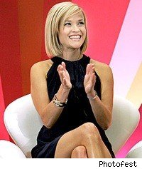 reese_witherspoon_smiling_chair