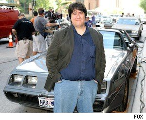 TVSquad's Danny Gallagher posing in front of Dan Stark's awesome Trans Am on the set of 'The Good Guys'