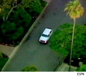 OJ Simpson pulls into his house during the infamous white Bronco chase - 'June 17, 1994' o