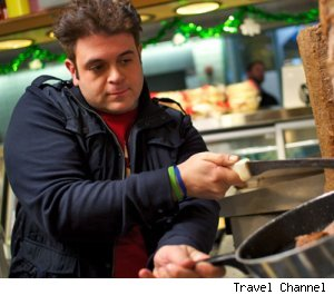 Adam Richman cutting some gyro meat in Cleveland on 'Man v. Food'
