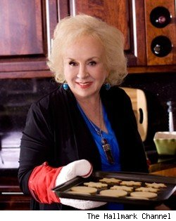 Doris Roberts as Mrs. Miracle
