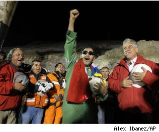 Freed miner Luis Uzura celebrates withPresident Sebastian Pinera