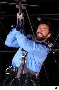 Hugh Jackman reacts after injuring his eye
