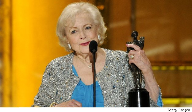 Betty White caresses her SAG award