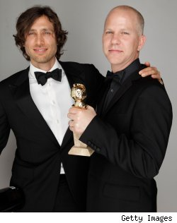 Brad Falchuk and Ryan Muphy of 'Glee' hold their Golden Globe for the show