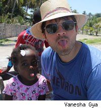 Misha Collins and a Haitian girl