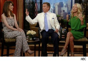Regis Philbin shows his hand test off to Rose Byrne on 'Live With Regis and Kelly'