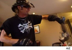 Billy the Exterminator grabs a squirrel