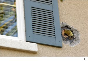Cannonball damage to Shetty family home